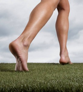 Bare legs on grass running towards better time management